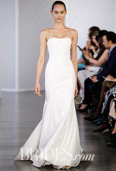 Brides.com: . Silk faille trumpet wedding dress with pearl and sequin embroidered panel, Oscar de la Renta