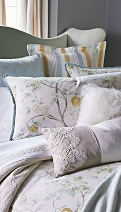 Inspired by the flowers that bloom at Spring's first blush, the Magnolia Bedding Collection is graced with a fresh floral print on duvet and shams, white romantic ruffles on bed skirt, cording, fringe and handpainted details on decorative pillows.  | Frontgate Interiors