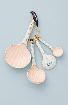 Bristol-based artist Liz Davies brings her sense of magical realism to the design for a set of charming measuring spoons in an intricate seashell design.