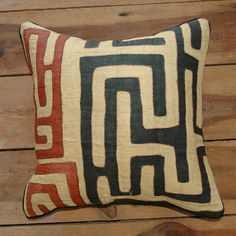 kuba pillow: kuba cloth is handmade in the democratic republic of the congo and then sewn into pillow covers by women in tanzania.