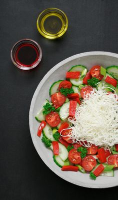 This traditional Bulgarian salad is bursting with wonderful flavors. Fresh tomatoes, cucumber, roasted peppers, onion, parsley and sirene cheese. http://feistyveggies.com/bulgarian-shopska-salad/