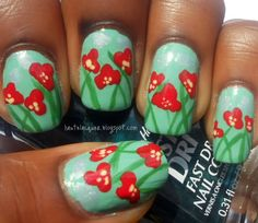 Poppies! Very cute flower nails.