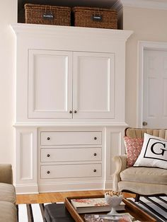 Source: bhg.com ~ HIDE TV IN SOMETHING LIKE THIS CABINET ~