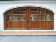 Spanish cedar carriage doors by M.S. Herman & Company.
