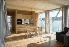 """A company in Portugal called Friday"""", have presented the Floatwing, a prefabricated floating houseboat that can be made to order and delivered almost anywhere in the world. The house has low impact on the environment, it uses materials and technolog"""