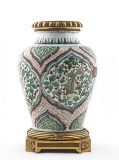 A Fine Chinese wucai jar, the ovoid body decorated with four medallions containing each one a large fish amidst algae and water weed. A tapering neck with green and red leaf shaped decoration and the shoulder with a design in pale blue. Later ormolu mounts applied to the bottom and rim, Late Ming Dynasty Heigth 37cm