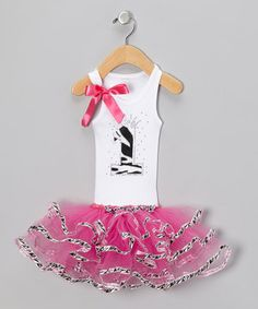 Celebrate the milestone that's a little one's birthday with this girly, twirly dress. The rhinestones, zebra appliqué and tulle skirt are more festive than the candles on the cake, while its stretchy cotton blend is comfy for girls to wear.