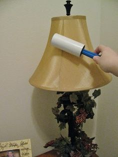 Use sticky tape lint roller to clean lampshades.