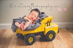 Smiling baby boy in Tonka truck