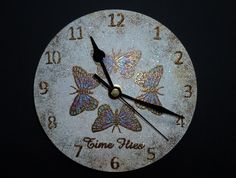 Small MDF 'Butterfly' Clock.   Imagination Craft's - Small MDF clock & Mechanism.  Small clock face stencil.  Cinnamonn Sparkle Medium.   Diamond Sparkle Medium.  Chalk White MDF paint. Blue paint brush.  'Time Flies' stamp set.  Pearly paint palette.  Brayer.  Versamark pad.  January 2015.