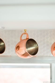 Copper Mugs and White Penny Tile