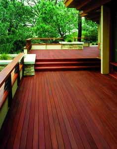 comparison article for deck stains -- (photo of large deck with burgundy-tinted stain from Behr) Deck Stain Colors, Deck Colors, Paint Colors, Wood Deck Texture, Exterior Stain, Exterior Angles, Exterior Colors, Wooden Decks, Building A Deck