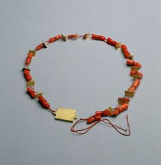Tereza Seabra. Necklace: Pompei, 2003. Gold, coral, silk thread, painted ivory by Antonio Marques.