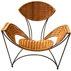 Rattan leaf shaped chair ~ Two of these.                                                                                                                                                                                 More