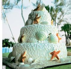 The Cake    Neither the bride nor the groom has much of a sweet tooth, but they raved about their three-tier, key lime–filled vanilla cake. Covered in white-chocolate seashells and coral-color starfish, the confection sat on a sand-like base made of natural sugar.    Cake: Mason's Bakery, Fort Myers   Photo By: Stehlik Photography