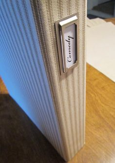 The Uncluttered Lifestyle: Making Standard Binders Pretty by covering with fabric