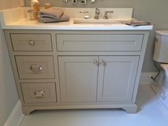 """Sherwin Williams """"Balanced Beige"""" vanity-- this would be pretty for our kitchen cabinets"""