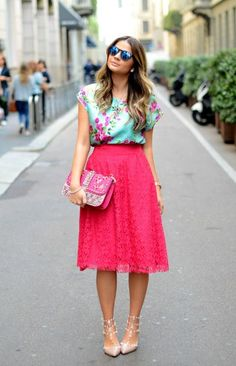 Shop this look on Lookastic:  https://lookastic.com/women/looks/sleeveless-top-midi-skirt-pumps-clutch-sunglasses-watch/10477  — Blue Sunglasses  — Mint Floral Sleeveless Top  — Gold Watch  — Hot Pink Embellished Leather Clutch  — Hot Pink Lace Midi Skirt  — Beige Studded Leather Pumps