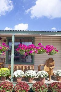 How to Remodel Your Mobile Home to Look Like a House from eHow. #porch