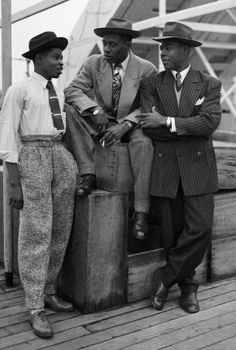 John Hazel, Harold Wilmot, and John Richards arriving at Tilbury docks aboard the Empire Windrush in 1948
