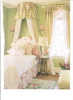 Beautiful! What girl would not love this charming room with it's sweet canopy, lovely colors & all the right finishing touches.