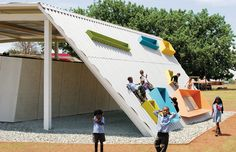 Olifantsvlei Primary School, Kliptown, Johannesburg, South Africa, designed by Institute of Experimental Architecture./Studio 3.The school building is integrated with the play area. From Design Like You Give a Damn [2]. Photo: ./Studio 3