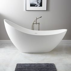 dingdingding and the winner is this stunner. it is matte on the outside and a totally contemporary take on the classic soaking tub and a whopping73 inches ling and right at $3,000.This is the tub would buy.
