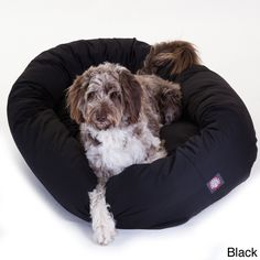 Fido will stop climbing into your bed when you treat him to this comfortable pet dog bed. The bed is great for all dogs and pets and it features a bolster around the edges that provides more support for your sleeping pet.