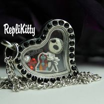 This fun set is for the Jack and Sally fans in all of us!  It comes with a Jack and Sally charm, a Jack skull, crystals, and a pearl.  They are displayed beautifully in a silver heart locket with black crystals. Handmade by RepliKitty www.replikitty.storenvy.com #nbc #jacksally #skellington