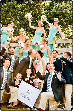 bridal party by bridge at The Whalehead Club in Corolla, NC www.brookemayo.com