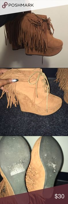 FRINGED WEDGES Tan wedges with fringes. The heel is about 5 inches tall. Lace up to put on. Only warn once, stepped on a rock and there's a very minor indentation on the bottom of the right shoe. True to size! Charlotte Russe Shoes Wedges