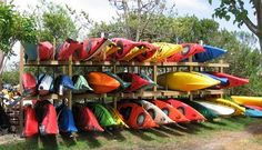 Herring's Outdoor Sports - Best one-stop shop on the island for beach rentals. Page goes to kayak info Kayak Storage Rack, Kayak Rack, Garage Storage, Canoe Shop, Surf Shop, Kayak Rentals, Small Backyard Pools, Surf City, Canoe And Kayak
