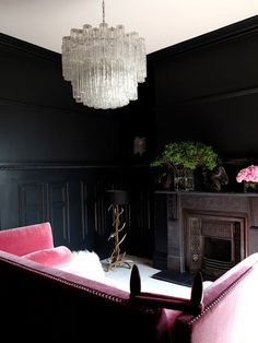THIS REALLY EXISTS?? BLACK WALLS AND A VELVET PINK COUCH!!!!!!!!!!!! I NEED THIS