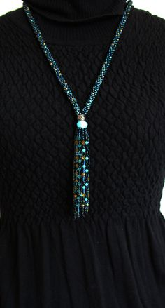 Kumihimo is a Japanese technique of braiding multiple strands of beads to create an intricate beaded rope. This necklace was hand crafted with love and finished with an array of sparkling Swarovski Crystals showcased in a very unique beaded fringe. The necklace hangs at 14.5 in length with an additional 4.5 in Swarovski Crystal beaded fringe that sparkles and moves with your natural rhythm. A ONE OF A KIND, MUST HAVE PIECE!  Be our Friend... Facebook.com/SeaSaltnPearls Instagram.com&#x2...