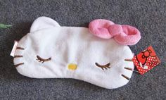 Imagen de http://img1.mlstatic.com/hello-kitty-antifaz-sanrio-para-dormir_MLM-O-3361124121_112012.jpg.