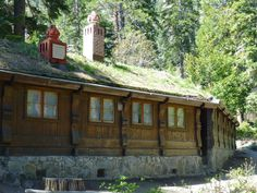 North wing with grass-seeded sod roof and chimneys, Vikingsholm Mansion, Emerald Bay, California