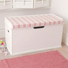 Toy Box Seat (Deckchair Pink Cushion) - Children love the idea of a toy box they can sit on!  A ledge at the back of this sturdy wooden toy storage chest holds the seat cushion in place, and when it's time to tidy up the safety hinge on the lid protects little fingers.