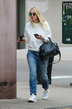 Casual outing: Dakota Fanning cut a typically casual figure as she was spotted out and abo...