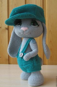 Here is a detailed crochet pattern of my Rowdy-Dowdy Bunny.  Pattern is written in ENGLISH.  This is a 28 pages PDF crochet pattern including all the information needed to create Rowdy-Dowdy Bunny.  Included: All materials required to complete your Rowdy-Dowdy Bunny; 37 color photographs; Step by Step Instructions.  The size of the bunny made with suggested materials is 22-23cm.  I dont think my toys are difficult to make, but you do need to have some crocheting experience:)  Your pattern…