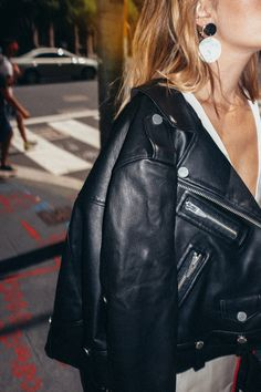 Carmen Hamilton wears leather jacket from The Arrivals NYC and earrings from Lucilla Grey. Street style in Sydney from CHRONICLES OF HER.