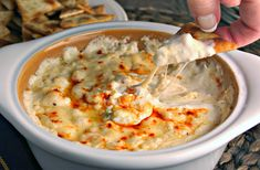 Cheesy Shrimp Dip makes a delicious dinner party appetizer. Serve hot and bubbly with pita chips, a sliced and toasted baguette, or assorted crackers.