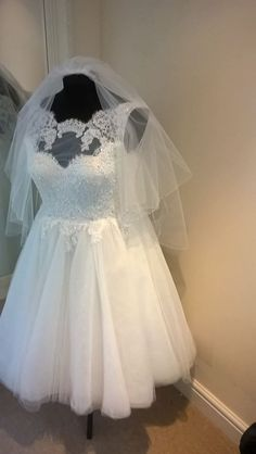 DeerHobbs bespoke tea length dress  Sweetheart bodice with lace overlay and full tulle skirt  Comes complete with veil  Size 12  Can be viewed at our boutique in Petersfield, Hampshire.  Professionally dry cleaned  RRP £1095  Sale Price £595 (incl veil) — in Petersfield