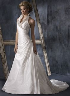 I love this high collared  gown BUT its too plain at the bottom Maggie Sottero, 2010, Pamela Royal wedding dress