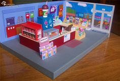This is one of my favorite dioramas, Apu´s Kwik-E-Mart from The Simpsons, to display the Playmates figures. It took a lot of time but it was fun to. The Simpsons Kwik-E-Mart custom diorama