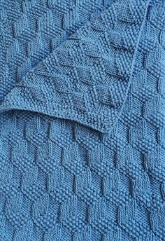 "Free Knitting Pattern for Reversible Tumbling Blocks Baby Blanket - Textured blanket creates a 3D block effect with knit and purl stitches that make it completely reversible. Designed by Susie Bonell for Cascade Yarns. 36"" x 43"" approx. blocked. Pictured project by Peeps444"