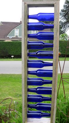 this type of fence would not require drilling holes in the bottles