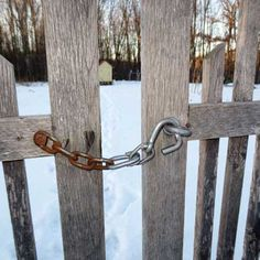 You'll never fumble while opening a gate again if you implement this reader's tip for a one-handed gate latch. Farm Gate, Farm Fence, Dog Fence, Diy Gate, Gate Latch, Barns Sheds, Mother Earth News, Dream Barn, Garden Gates