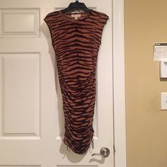 NWOT Michael Kors Animal Print Dress size Small NEW without tags Retail $130, Michael Kors Animal Print Dress size Small. Ruches on the sides to shorten. Would look great with the red patent heels I'm selling ;) Purchase 3+ items and save 10%. Michael Kors Dresses