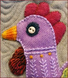 detail from Bird Dance by Sue Spargo, wool applique wall quilt, photo by Robin Atkins   Beadlust