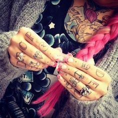 Pink hair, pink nail, and tattoos....doin it
